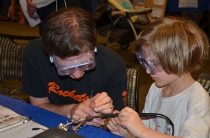 Learning how to solder at the Ann Arbor mini Maker Faire