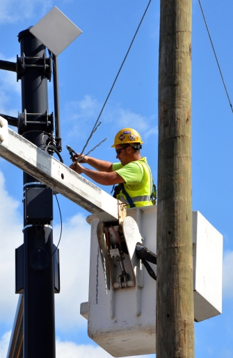 COLUMBUS, OH - JUNE 27: An electrician works on an electrical pole near the Convention Center on June 27, 2017.